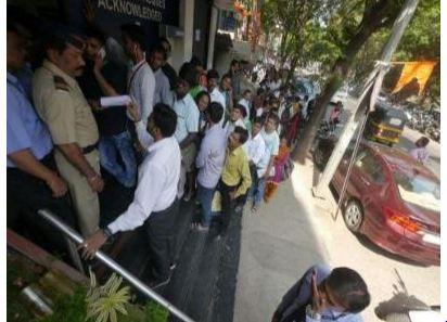 People give ATM queues a miss, go shopping instead