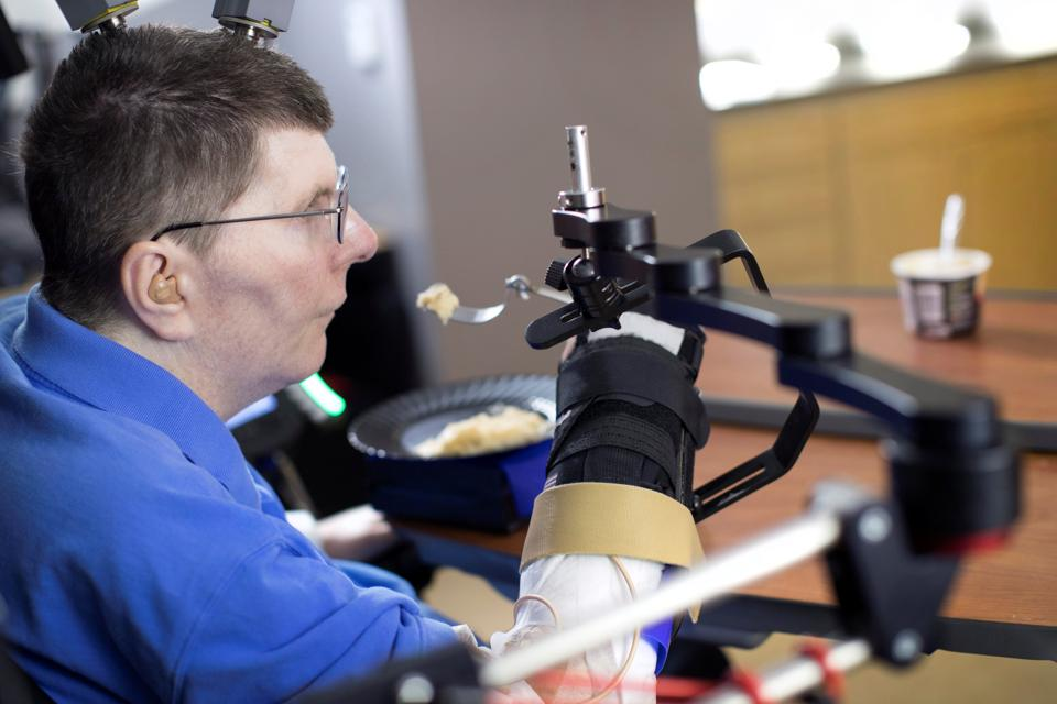 Paralysed man moves arms using thought-controlled technology, reveals study