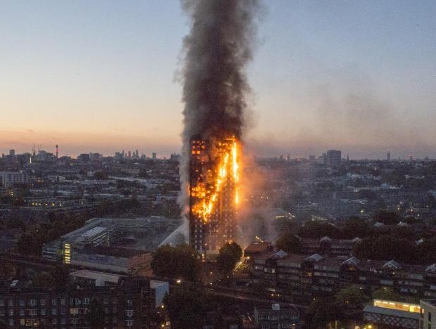 Engulfs tower fire: Massive fire engulfs 27-storey London tower, several trapped in homes