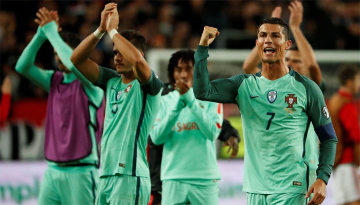 Portugal hang on to win bruising battle with 10-man Hungary