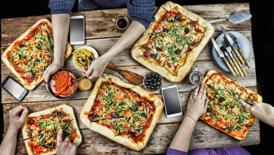 Do you associate pizzas with parties? Your weight may determine how you think of food
