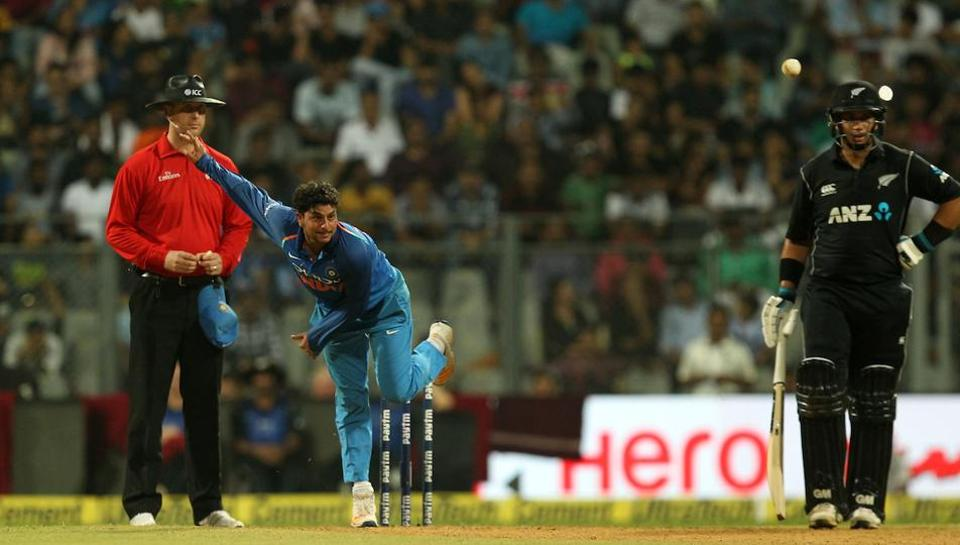 Dinesh Karthik defends Indian cricket team spinners after loss to New Zealand.