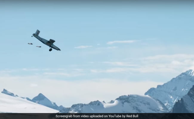 Watch: Daredevils Jump Off Mountain, Land Inside A Plane In Insane Mid-Air Stunt