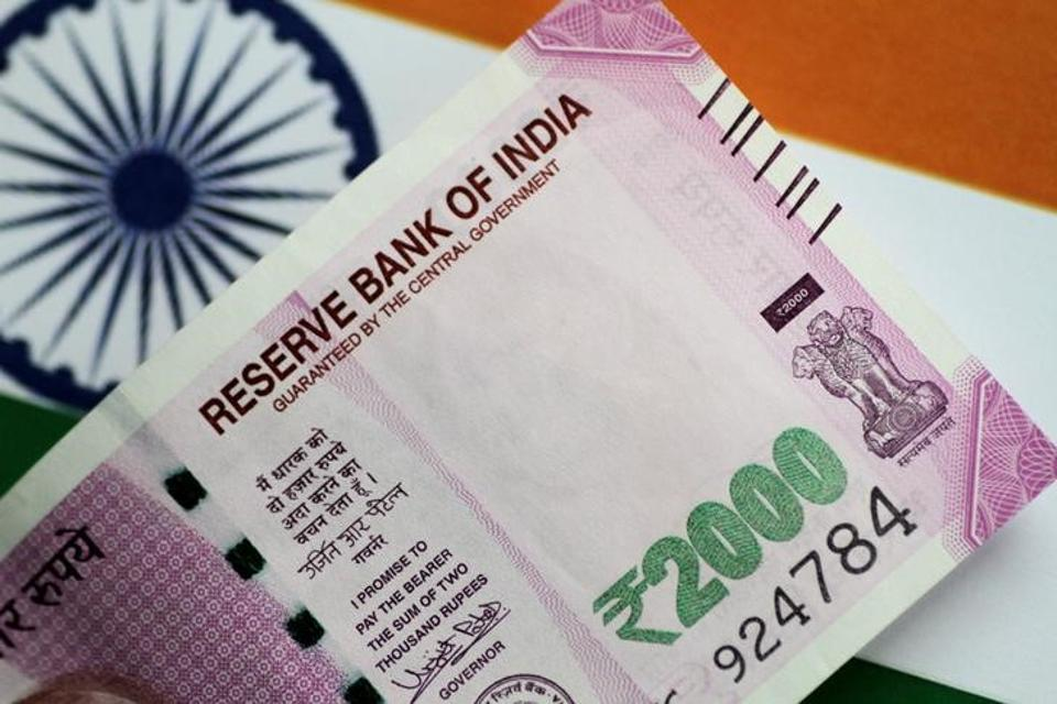Rupee opens flat against US dollar as traders await key economic data