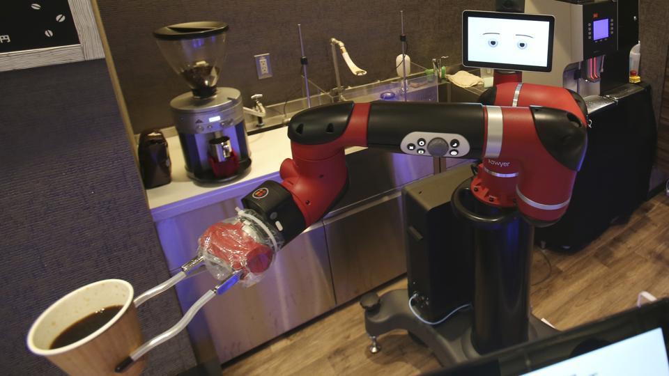 A robot barista serves you coffee at this café in Tokyo
