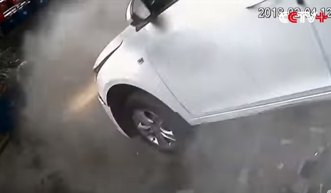 Car Smashes Through Parking Lot Wall, Drops From Second Floor. Watch