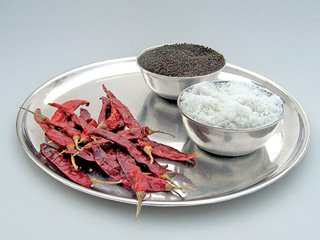 Method of casting off the evil eye using salt and red chillies together