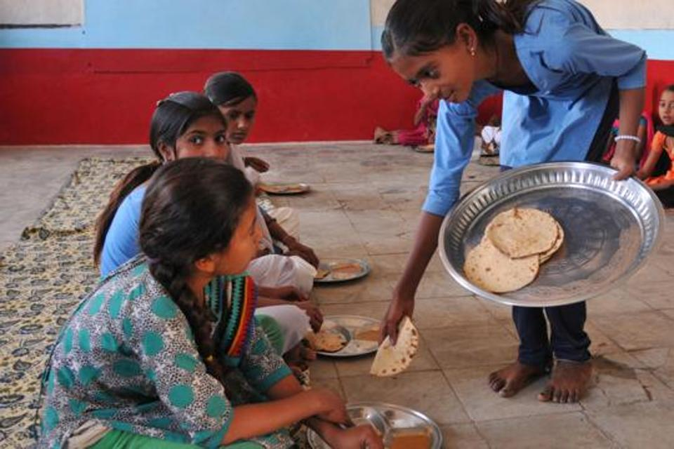 With no kitchen, govt school in MP prepares midday meals in washroom