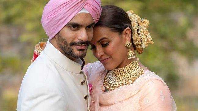 Neha Dhupia trolled for marrying younger man Angad Bedi. Her response is epic