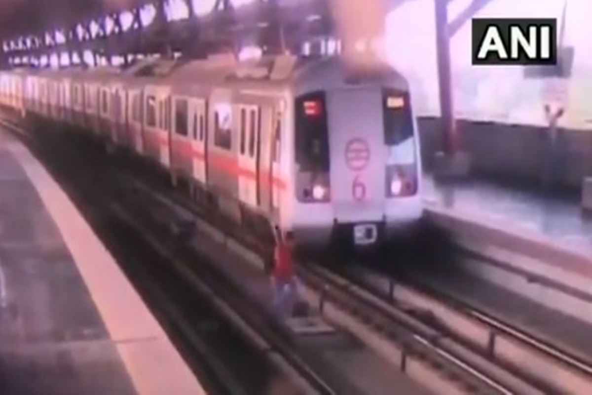 Bone-chilling video! Man narrowly escapes death while crossing Delhi Metro tracks