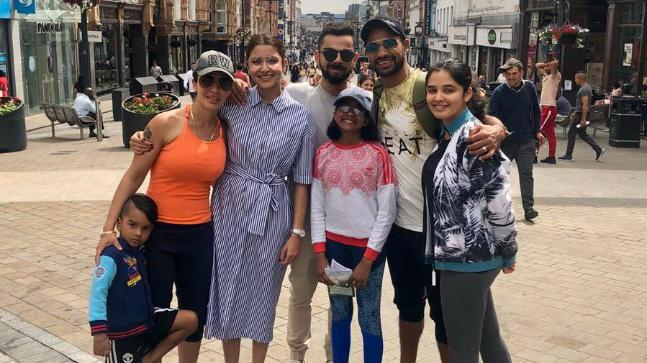 Strolling on the streets in England: Shikhar Dhawan, Virat Kohli and Anushka