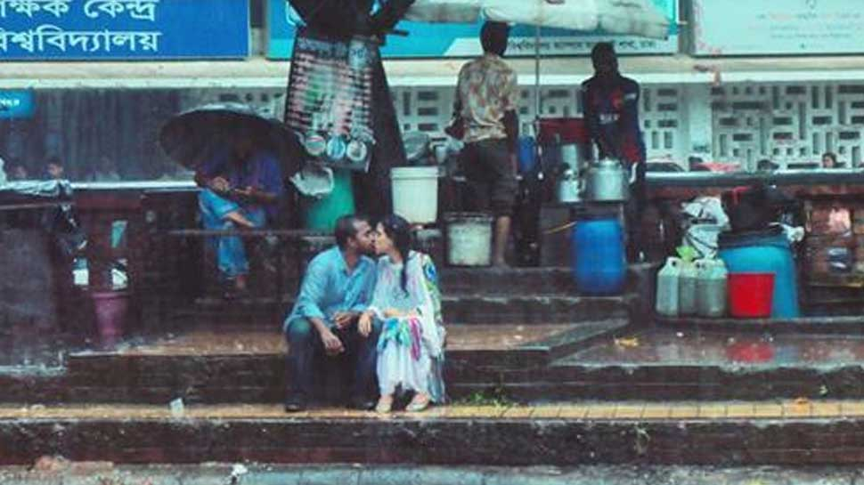 Bangladeshi photographer thrashed, fired from job for clicking young lovers kissing in rain