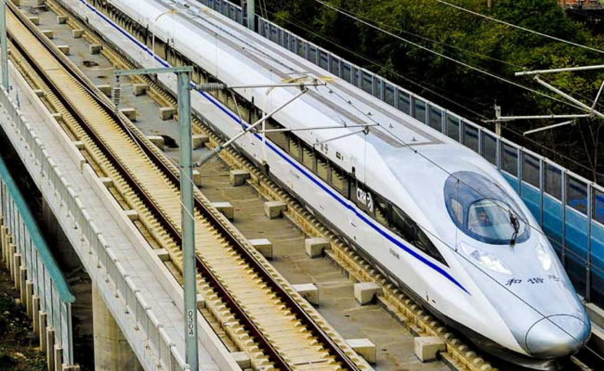 Hair-Raising! Japan Bullet Train Staff Made To Sit By Tracks