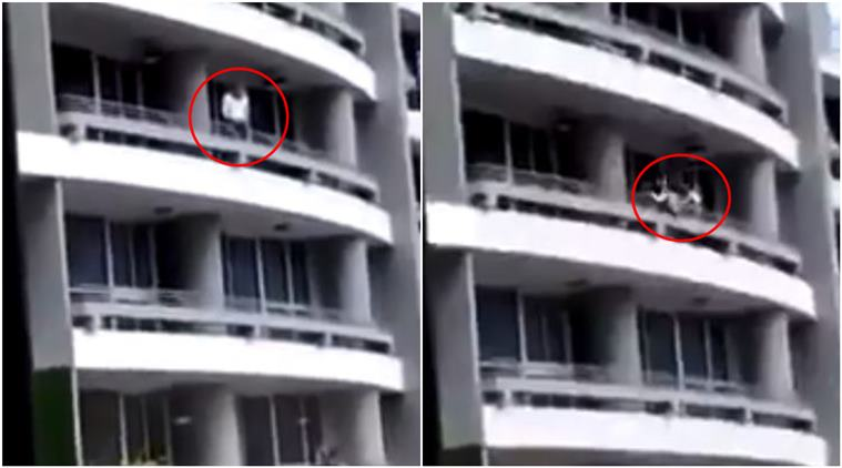 Horrific moment when woman falls off building while taking a selfie
