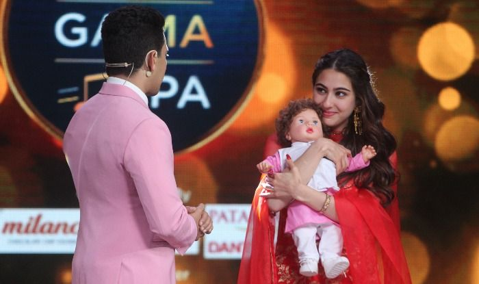 Sara Ali Khan cuddles with Taimur Ali Khan doll gifted to her on reality show. See pics