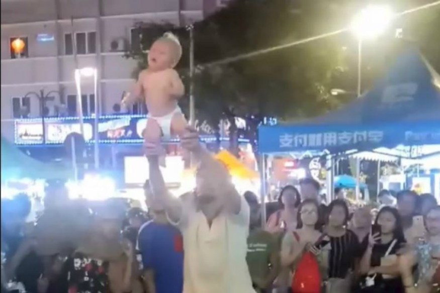 Couple Seen Violently Swinging Their Baby To