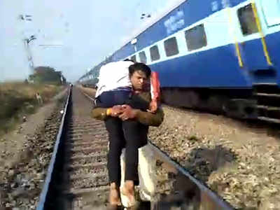 Watch: Carrying Injured Man, Madhya Pradesh Cop Runs On Rail Track