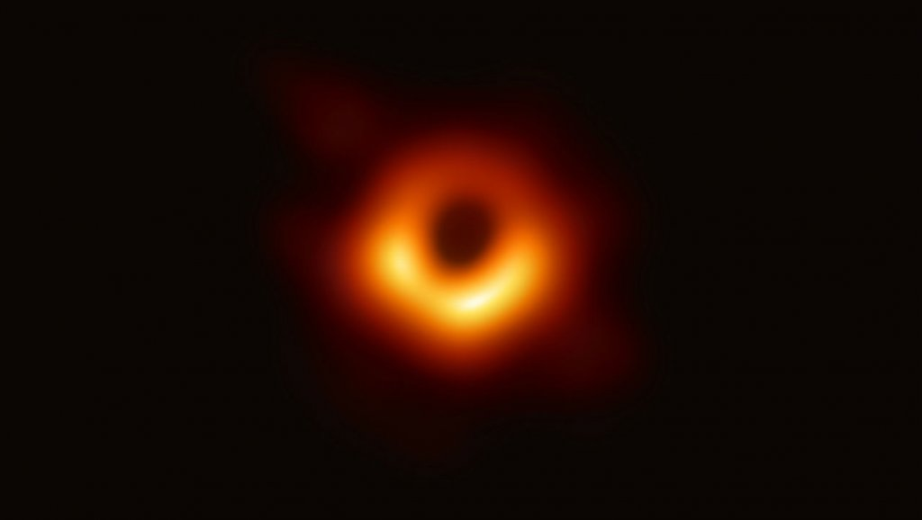 Astronomers unveil first photo of a black hole