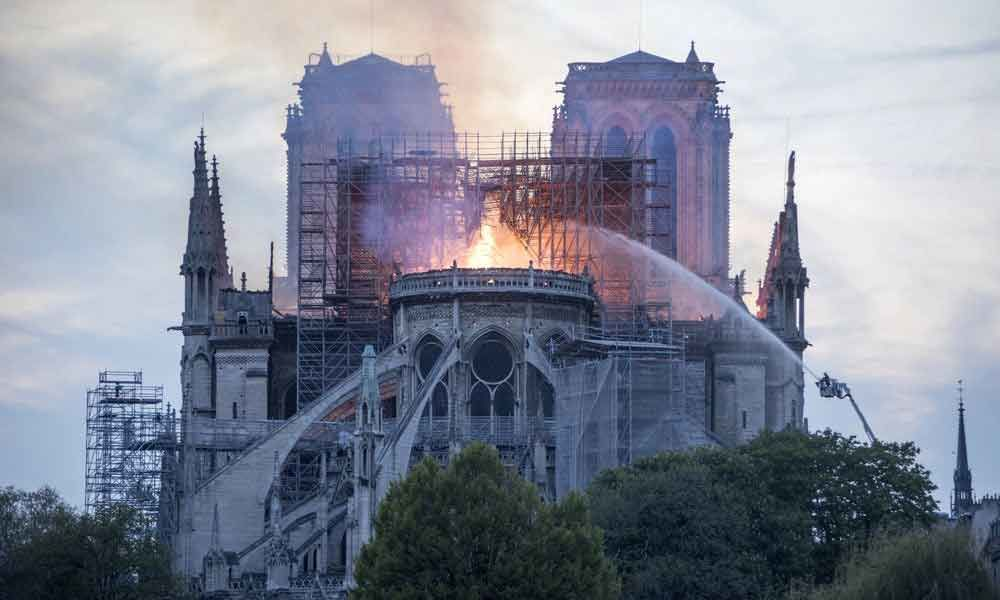 'Worst avoided,' says Macron on Notre Dame fire; vows to re-build cathedral