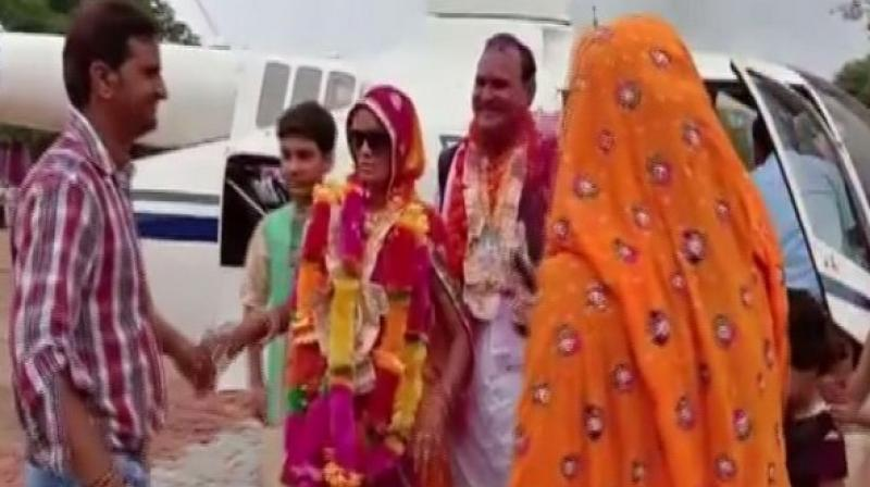 On Retirement Day, Rajasthan Teacher Books Chopper To Fly Wife Home