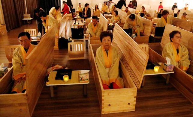 South Koreans Lie Inside Closed Coffins For 10 Minutes To Simulate Death