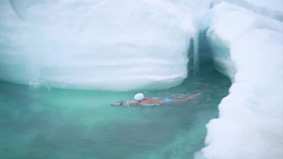 A climate activist swam under the Antarctic ice sheet to prove how quickly glaciers are melting