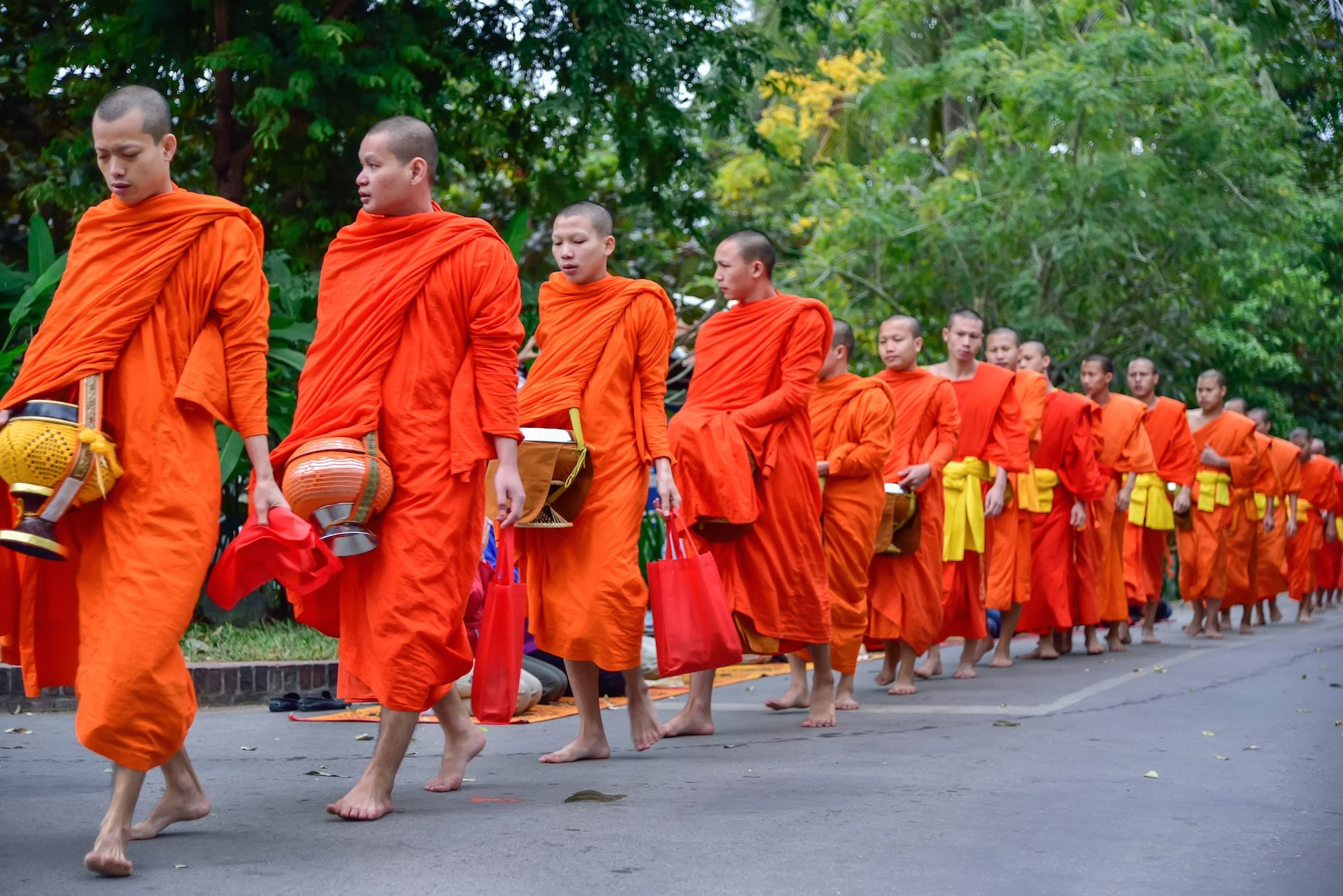 Why do Buddhist Monks wear Orange Robes and Shave their Heads?