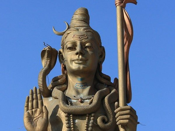 What is the significance of the snake around Lord Shiva