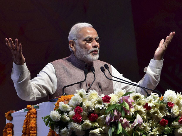 PM Modi urges industry to adopt new business models, work culture