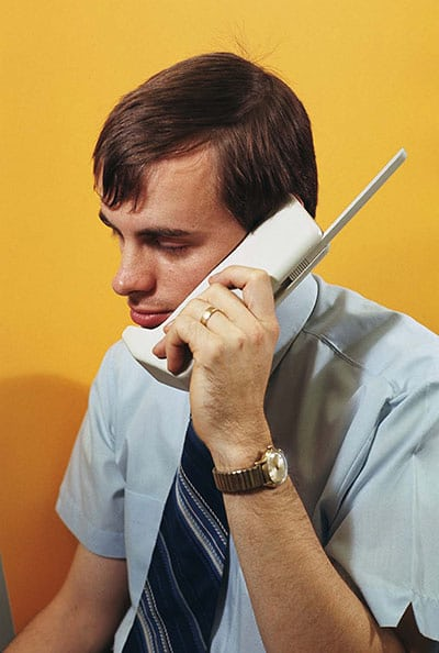 Product designer with Motorola DynaTAC mobile concept phone in 1972.