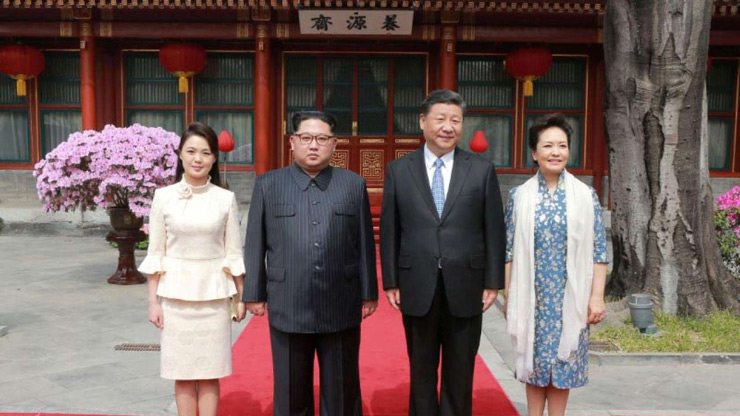 North Korean leader Kim Jong Un and wife Ri Sol Ju, and China President Xi Jinping and wife Peng Liyuan pose for a photo - KCNA