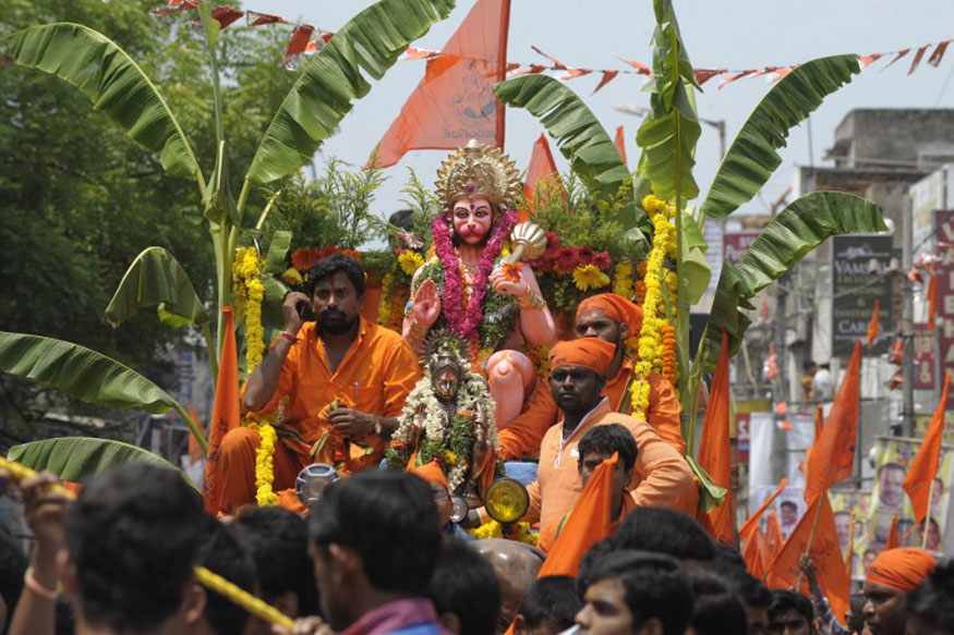 Devotees participate in a procession for Hanuman Jayanti, the birthday of the Hindu monkey-god Lord Hanuman, in Hyderabad.
