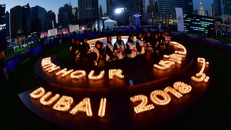 People light candles after the building lights were switched off for the Earth Hour environmental campaign in Dubai.