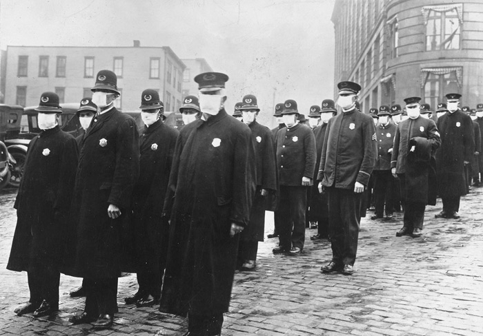 1.Policemen stand in a street in Seattle, Washington, wearing protective masks made by the Seattle Chapter of the Red Cross, during the influenza epidemic in 1918. #