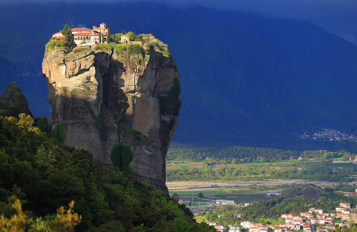 1.The rising sun illuminates the Monastery of the Holy Trinity and parts of nearby village of Kalabaka below, at the Meteora rock formation in central Greece.