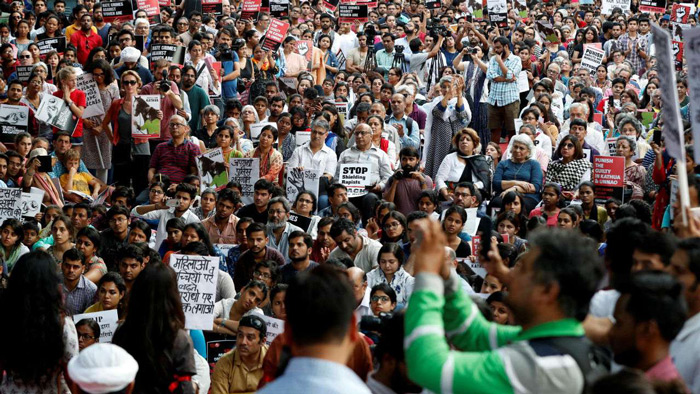 People attend a protest against the rape of an eight-year-old girl, in Kathua, near Jammu and a teenager in Unnao, Uttar Pradesh state, in New Delhi, India April 15, 2018.