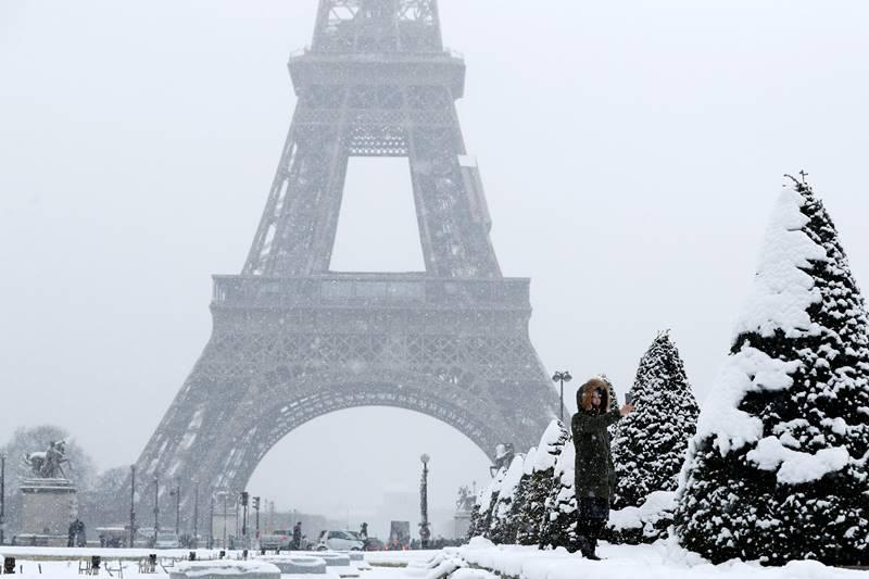 Snow and freezing rain pummeled parts of France on Friday, shutting down the Eiffel Tower but covering Paris in a gorgeous coat of white.