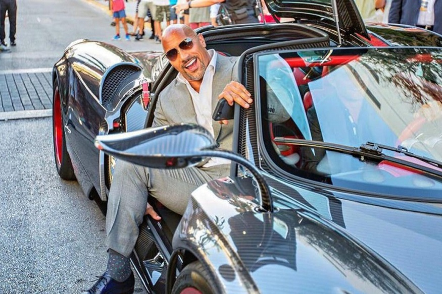 It's quite hard to imagine a 6'4 muscular man driving around in a Pagani Huayra sports car but yes, Dwayne Johnson managed to arrive at the premiere of the hit HBO show Ballers. Priced at $1.3 million the Pagani Huayara was limited to just 100 units as part of Pagani