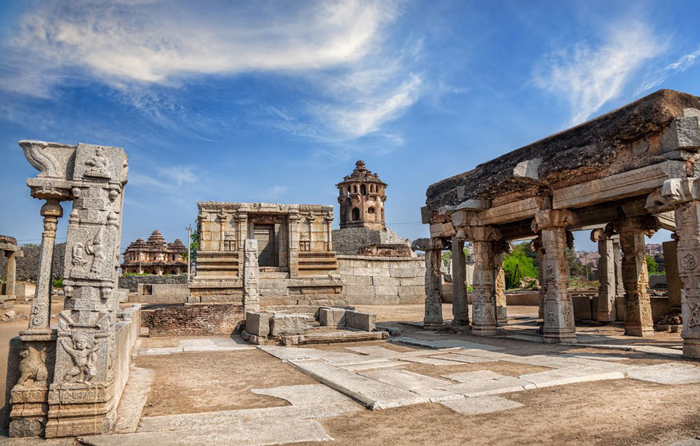 1. Visit the temples and ruins of Hampi.