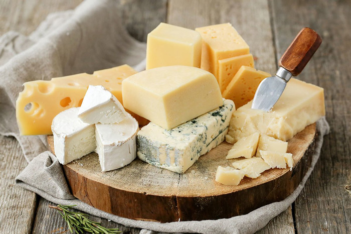 1. Cheese Yes, cheese is rich in calcium which strengthens the gums and the teeth. Having cheese also lowers the acid level in your mouth and increases the production of saliva which washes off some of the bacteria in the mouth. Just remember, hard, aged cheese are the best options.