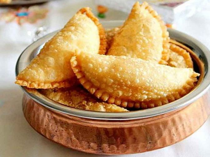 1. Gujiya is an authentic holi sweet dish that is popular in North India but is enjoyed by people pan-India. Click here to see the recipe.