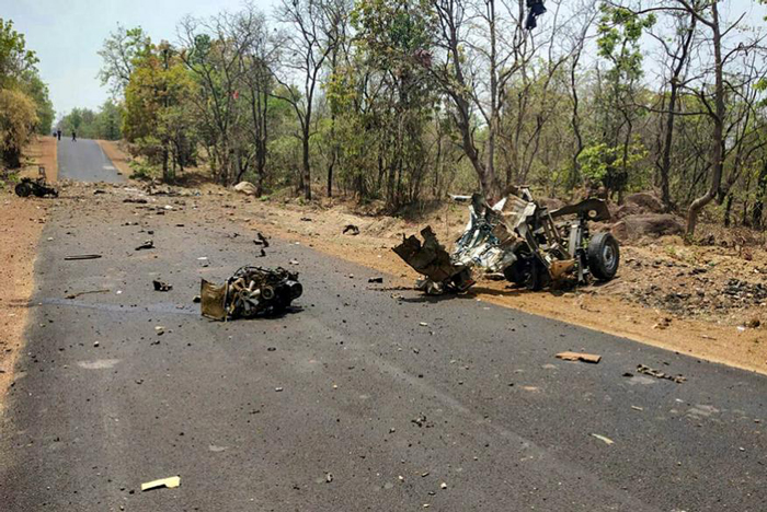 Mangled remains of a police vehicle, carrying 16 security personnel that was allegedly blasted by Maoists using IED, in Gadchiroli.