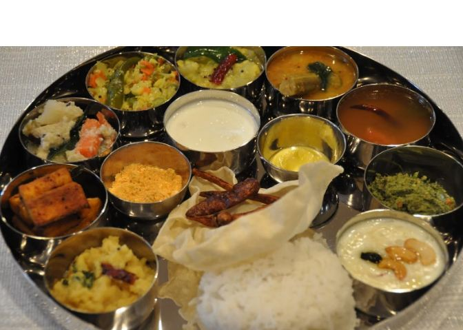 1. South Indian Thali Indians are known for elaborate meals and the South Indian thali is the best example of it. There is no