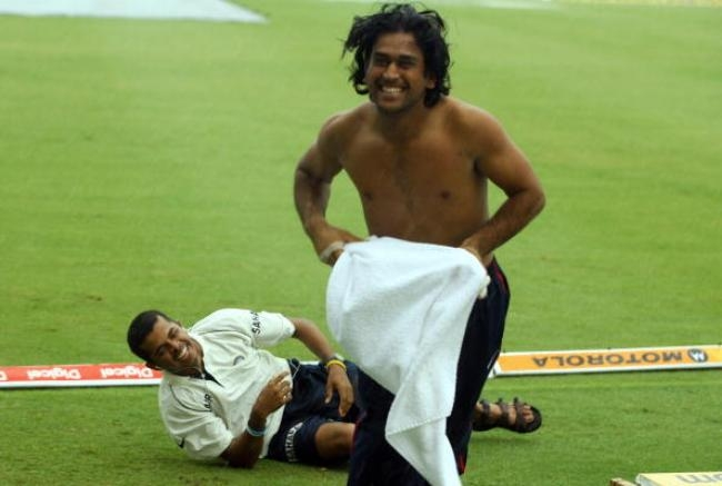 Dhoni spending some funny moments with teammate S. Sreesanth on the fourth day of the second test between India and West Indies at the Beausejour stadium in Gros Islet, St. Lucia 13 June 2006.
