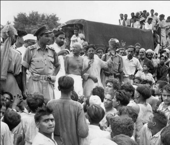 The father of the nation Mahatma Gandhi meets Muslim refugees who have gathered at a camp in New Delhi. These individuals belonging to the minority group were proceeding to the newly formed nation, Pakistan.