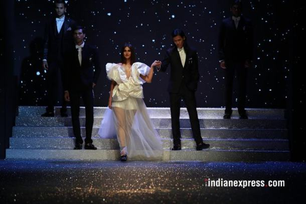 Vaani Kapoor began the show, which closed Day 1 of the gala on Wednesday, in a white dreamy floor sweeping sheer outfit with ruffles designed by Gauri and Nainika.