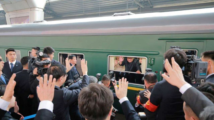 North Korean leader Kim Jong Un waves from a train, as he paid an unofficial visit to China, in this undated photo released by North Koreas Korean Central News Agency (KCNA) in Pyongyang March 28, 2018.