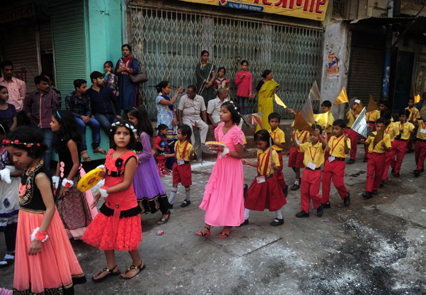 School children participate in a religious procession as part of Hindu festival of Hanuman Jayanti in Allahabad.