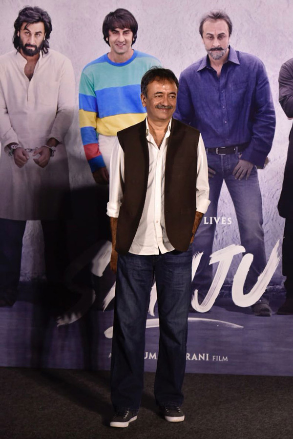 Rajkumar Hirani poses for a photo on his arrival at the trailer launch of