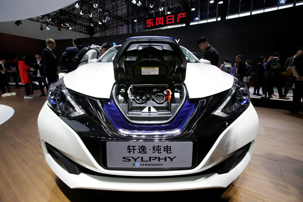 A Nissan SYLPHY electric car is displayed during a media preview of the Auto China 2018 motor show in Beijing, China.